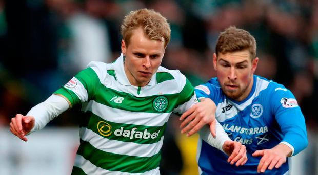 St Johnstone's David Wotherspoon and Celtic's Gary Mackay-Steven battle for the ball during the Ladbrokes Scottish Premiership match. Photo: Jane Barlow/PA