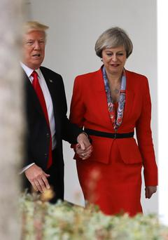 British Prime Minister Theresa May with U.S. President Donald Trump walk along The Colonnade at The White House (Photo by Christopher Furlong/Getty Images)