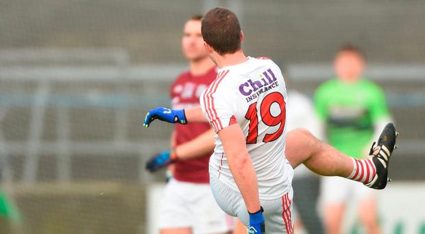 Colm O'Neill of Cork watches his late free to win the game go narrowly wide. Photo: David Maher/Sportsfile