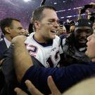 New England Patriots' Tom Brady celebrates with head coach Bill Belichick after winning the NFL Super Bowl 51 football game against the Atlanta Falcons in overtime (Image: AP)