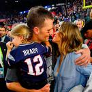 Tom Brady #12 of the New England Patriots celebrates with wife Gisele Bundchen and daughter Vivian Brady after defeating the Atlanta Falcons during Super Bowl 51 at NRG Stadium on February 5, 2017 in Houston, Texas. The Patriots defeated the Falcons 34-28. (Photo by Kevin C. Cox/Getty Images)