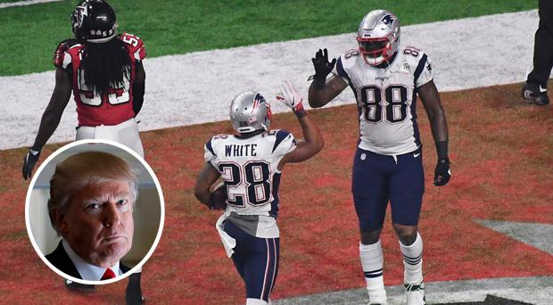 New England Patriots running back James White (28) reacts with tight end Martellus Bennett (88) after scoring a touchdown against the Atlanta Falcons