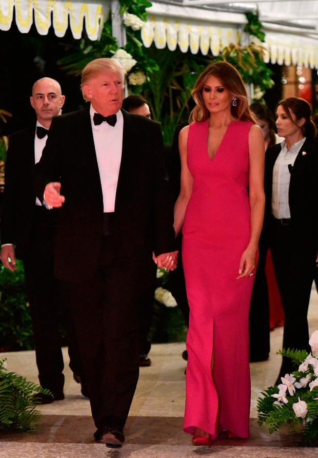 US President Donald Trump and First Lady Melania Trump arrive for the 60th Annual Red Cross Gala at his Mar-a-Lago estate in Palm Beach on February 4, 2017. / AFP PHOTO / MANDEL NGANMANDEL NGAN/AFP/Getty Images