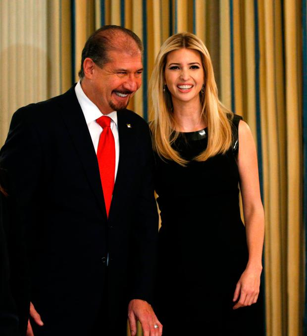 7a9933be44c0 Ernst & Young CEO Mark Weinberger talks with Ivanka Trump as U.S. President Donald  Trump hosts
