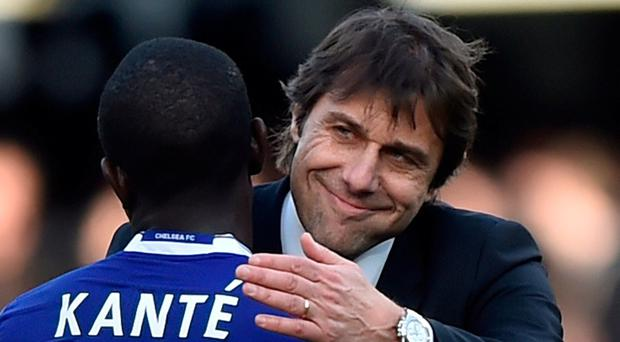 Chelsea manager Antonio Conte and N'Golo Kante celebrate after the win over Arsenal