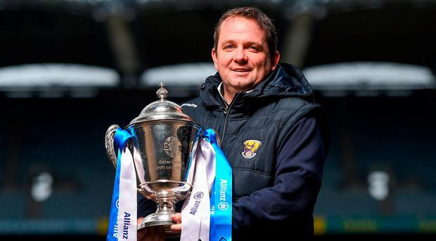 Wexford boss Davy Fitzgerald with the Allianz HL Division 1A trophy at yesterday's launch in Croke Park. Photo: Seb Daly/Sportsfile