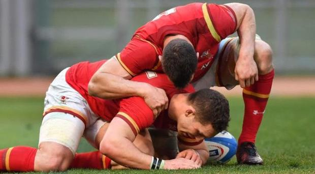 George North, bottom, is struggling to be fit to play England at the weekend after hurting his leg during Wales' victory over Italy. CREDIT: ALBERTO PIZZOLI/AFP/GETTY IMAGES