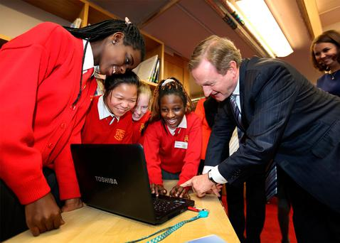 Taoiseach Enda Kenny meets Coderdojo members Aicha, Nichola, Caitlin and Guylor (all aged 12) at Loreto Primary School in Crumlin, Dublin, for the launch of the Action Plan for Education 2017. Photo: Frank McGrath