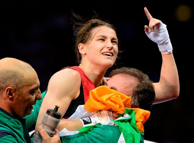 Katie Taylor celebrates after winning gold at the 2012 Olympic Games. Photo: David Maher / SPORTSFILE