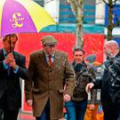 Eggs are thrown at Nigel Farage, left, as he greets Ukip leader Paul Nuttall, second left, in Stoke, England yesterday. Photo: Peter Byrne/PA