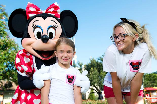 Jamie Lynn Spears poses with her six-year-old daughter Maddie and Minnie Mouse in front of Cinderella Castle at the Magic Kingdom park August 14, 2014 in Lake Buena Vista, Florida.