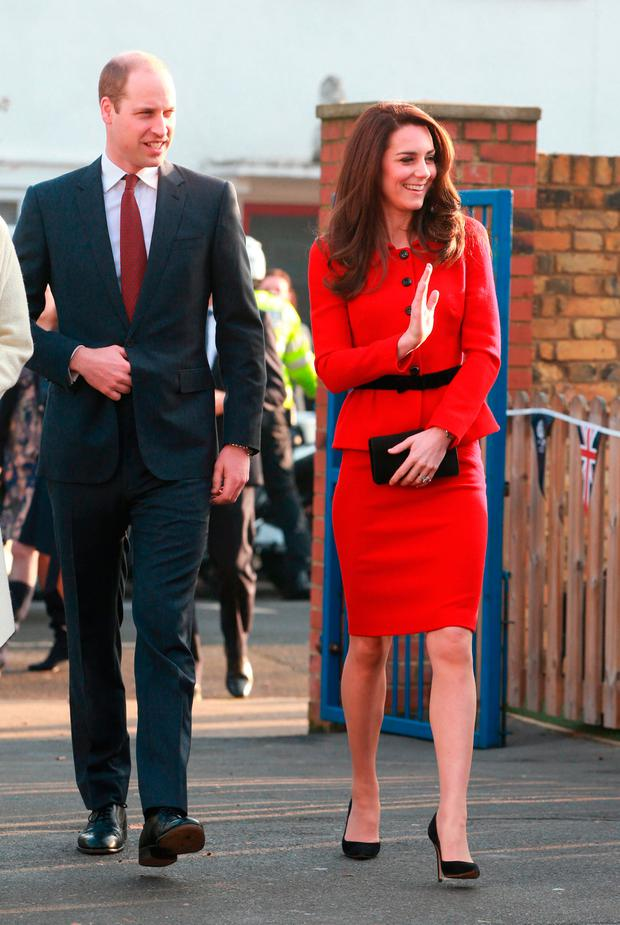 Britain's Prince William (L), Duke of Cambridge and Catherine, Duchess of Cambridge arrive to attend a big Assembly at a primary school in London to mark Children's Mental Health Week