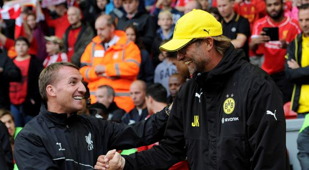 LIVERPOOL, ENGLAND - AUGUST 10: (THE SUN OUT, THE SUN ON SUNDAY OUT) Brendan Rodgers manager of Liverpool shakes hands with Borussia Dortmund manager Jurgen Klopp before the Pre Season Friendly match between Liverpool and Borussia Dortmund at Anfield on August 10, 2014 in Liverpool, England. (Photo by John Powell/Liverpool FC via Getty Images)