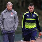 Laurent Koscielny (right) has questioned Arsene Wenger (left) for his team selection against Chelsea. Getty
