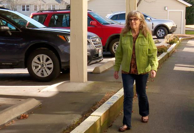 Gayle McCormick walks outside her new apartment in this still photo taken from video, in Bellingham, Washington February 2, 2017. Photo taken February 2, 2017. REUTERS/Tim Exton/ReutersTV