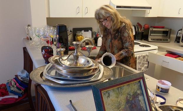Gayle McCormick works in her kitchen in this still photo taken from video, inside her new apartment in Bellingham, Washington February 2, 2017. Photo taken February 2, 2017. REUTERS/Tim Exton/ReutersTV