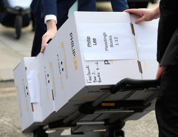 Boxes of evidence are brought into court. Photo: Collins Courts