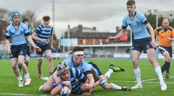 Ciaran McCarrick of Castleknock College scores his side's first try despite the tackle of Jack Boyle of St Michaels College during the Bank of Ireland Leinster Schools Junior Cup Round 1 match between St Michaels College and Castleknock College at Donnybrook Stadium in Dublin Photo by Ramsey Cardy/Sportsfile