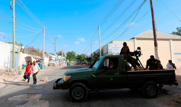 Somali government soldiers guard a road which was blocked to control motor vehicle traffic, during a security lock down in Somalia's capital Mogadishu, February 7, 2017. REUTERS/Feisal Omar