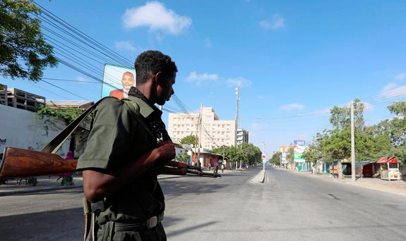 A Somali policeman stands guard along a road which was blocked to control motor vehicle traffic, during a security lock down in Somalia's capital Mogadishu, February 7, 2017. REUTERS/Feisal Omar
