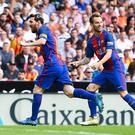 VALENCIA, SPAIN - OCTOBER 22: Lionel Messi (L) of FC Barcelona celebrates with his team mate Ivan Rakitic after scoring his team's first goal during the La Liga match between Valencia CF and FC Barcelona at Mestalla stadium on October 22, 2016 in Valencia, Spain. (Photo by David Ramos/Getty Images)