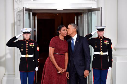 President Barack Obama (R) gives Michelle Obama a kiss as they wait for President-elect Donald Trump and wife Melania at the White House before the inauguration on January 20, 2017 in Washington, D.C. Trump becomes the 45th President of the United States. (Photo by Kevin Dietsch-Pool/Getty Images)