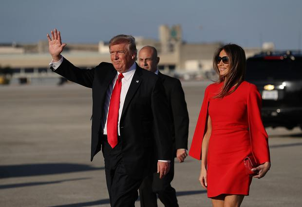 U.S. President Donald Trump walks with his wife Melania Trump on the tarmac after he arrived on Air Force One at the Palm Beach International Airport for a visit to his Mar-a-Lago Resort for the weekend on February 3, 2017 in Palm Beach, Florida. President Donald Trump is on his his first visit to Palm Beach since his inauguration. (Photo by Joe Raedle/Getty Images)