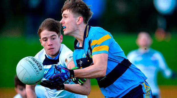 Mick Fitsimons of UCD in action against Mark Bradley of Ulster University during the Independent.ie HE GAA Sigerson Cup Quarter-Final match between Ulster University and UCD at Jordanstown in Belfast. Photo by Oliver McVeigh/Sportsfile