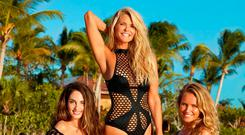 Always in style: Christie Brinkley and her daughters Alexa (to her left) and Sailor.