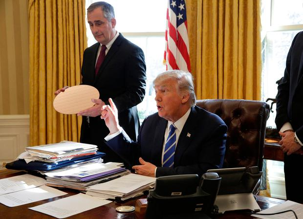 U.S. President Donald Trump points as Chief Executive Officer of Intel Brian Krzanich (L) displays a silicon wafer for making chips in the Oval Office of the White House in Washington, U.S., February 8, 2017. REUTERS/Joshua Roberts