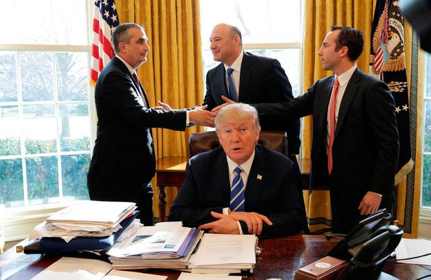 U.S. President Donald Trump speaks as Chief Executive Officer of Intel Brian Krzanich (L) shakes hands with Gary Cohn (C), head of the National Economic Council and Reed Cordish, assistant for intragovernmental and technology initiatives REUTERS/Joshua Roberts