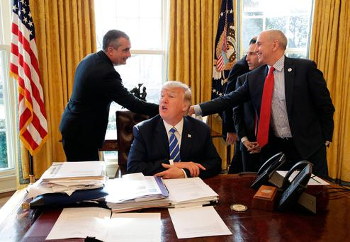 U.S. President Donald Trump as Chief Executive Officer of Intel Brian Krzanich shakes hands with members of the White House staff in the Oval Office of the White House in Washington, U.S., February 8, 2017. REUTERS/Joshua Roberts