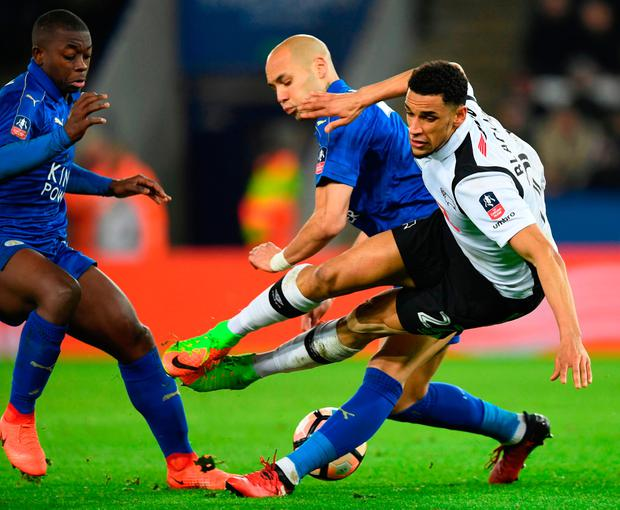 Leicester City's Yohan Benalouane (C) tackles Derby County striker Nick Blackman. Photo: AFP/Getty Images