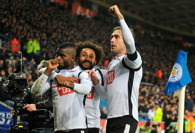 Derby's Abdoul Camara, left, celebrates his equalizer with teammates Ikechi Anya, centre, and Richard Keogh. Photo: AP Photo/Rui Vieira