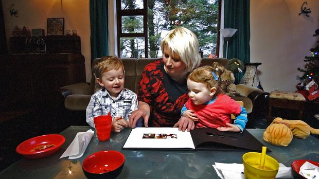 Sabina Collman, wife of Russell, with their children Hayden and Lily