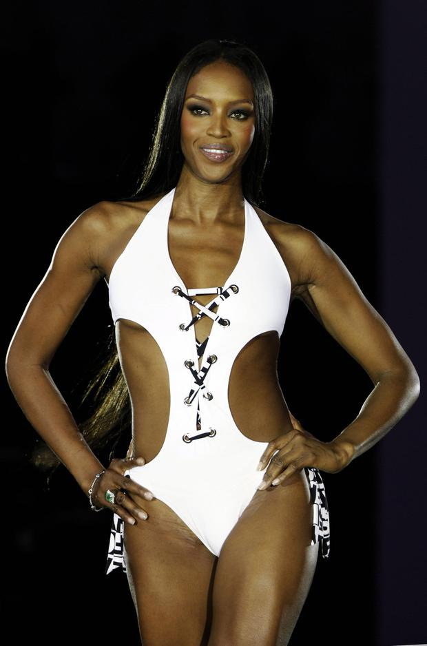 Super model Naomi Campbell presents a swimsuit during a fashion show of the GQ Style Night 09 July 2007 in Munich, southern Germany. (Photo credit SASCHA SCHUERMANN/AFP/Getty Images)