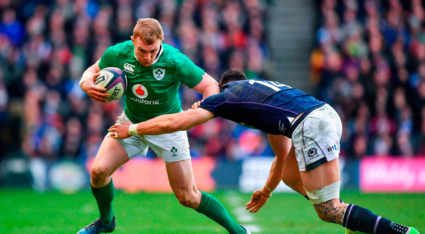 Keith Earls of Ireland is tackled by Sean Maitland of Scotland