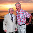 President Michael D Higgins with Fr Peter Hughes as the sun sets over Lima. Photo: Maxwells