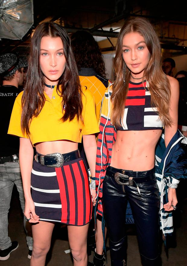 d2f10dfabb628 Models Bella Hadid (L) and Gigi Hadid are seen backstage at TommyLand Tommy  Hilfiger