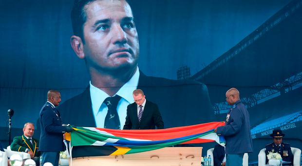 The South African flag is laid on the coffin of former South African rugby player Joost van der Westhuizen during a memorial service at Loftus rugby stadium on February 10, 2017 in Pretoria, South Africa.