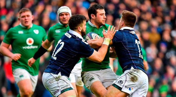 Robbie Henshaw of Ireland is tackled by Alex Dunbar, left, and Huw Jones of Scotland during the RBS Six Nations Rugby Championship match between Scotland and Ireland at BT Murrayfield Stadium in Edinburgh, Scotland. Photo by Brendan Moran/Sportsfile