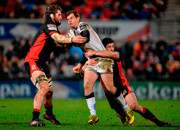 Louis Ludik of Ulster is tackled by Ben Toolis and Phil Burleigh of Edinburgh. Photo: Oliver McVeigh/Sportsfile