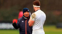 Eddie Jones in conversation with Jack Clifford at squad training. Photo: PA