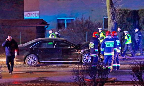 Police and fire brigade officers inspect Polish Prime Minister's Beata Szydlo's car after an accident in Oswiecim, Poland (AP Photo)