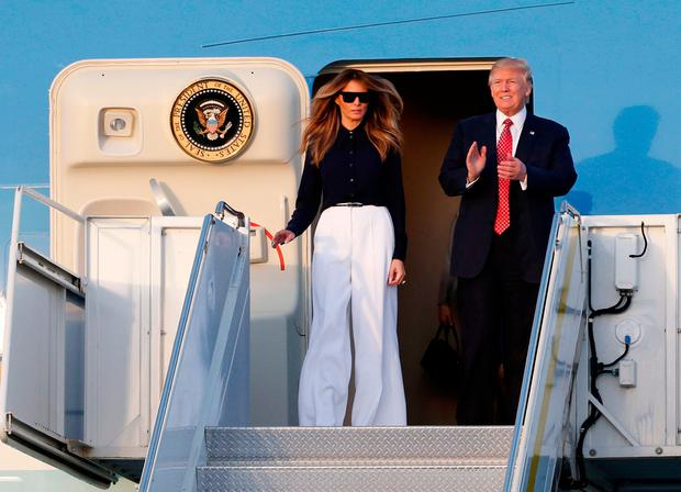 President Donald Trump and first lady Melania Trump prepare to step off of Air Force One as they arrive in West Palm Beach, Fla., Friday, Feb. 10, 2017. (AP Photo/Wilfredo Lee)