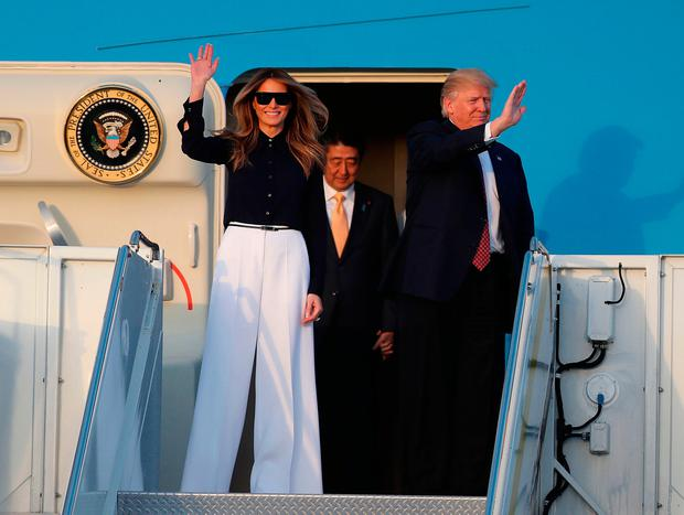 President Donald Trump and his wife Melania Trump arrive with Japanese Prime Minister Shinzo Abe on Air Force One at the Palm Beach International Airport as they prepare to spend part of the weekend together at Mar-a-Lago resort on February 10, 2017 in West Palm Beach, Florida.
