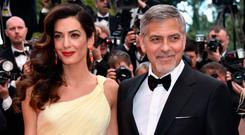 Lawyer Amal Clooney (L) and actor George Clooney attend a screening of