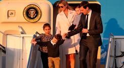 Jared Kushner and his wife Ivanka Trump walk off Air Force One with their children at Palm Beach International airport as they prepare to spend part of the weekend together with her father President Donald Trump at Mar-a-Lago resort on February 10, 2017 in West Palm Beach, Florida.