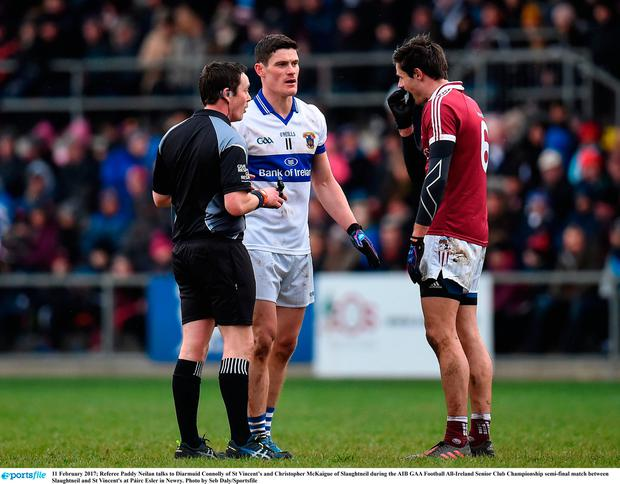 Referee Paddy Neilan talks to Diarmuid Connolly of St Vincent's and Christopher McKaigue of Slaughtneil