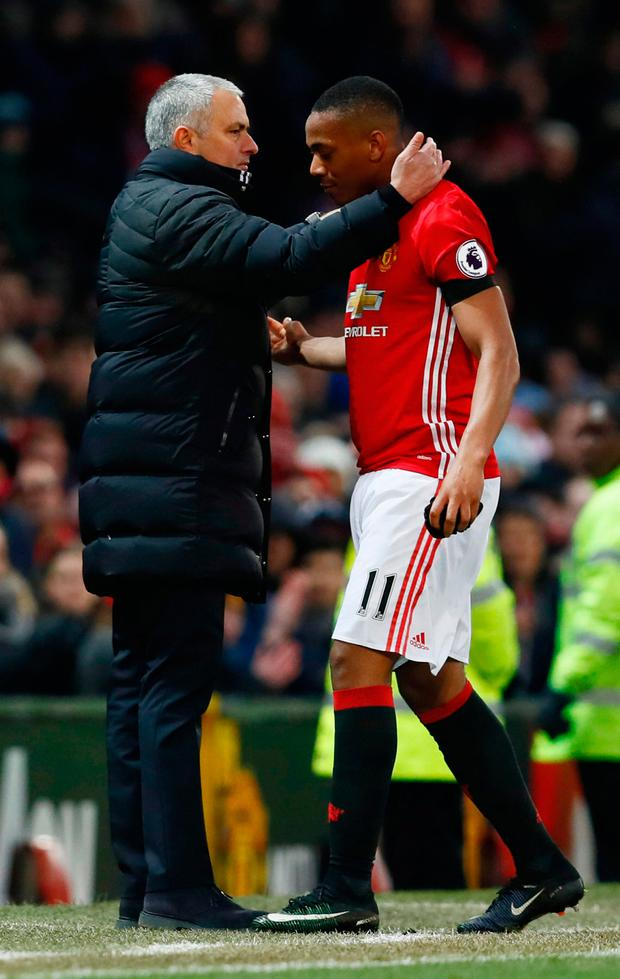Manchester United's Anthony Martial is congratulated by manager Jose Mourinho